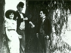 Mabel Normand, Mack Sennett, and Charles Chaplin in The Fatal Mallet (1914)