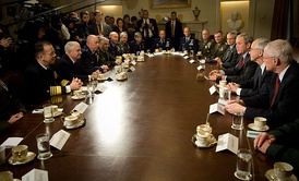 President George W. Bush (sitting third from the right) and Secretary of Defense Robert Gates (sitting second from the left) meeting with the joint chiefs and combatant commanders