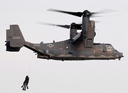 SEALs being hoisted into a CV-22 Osprey from the Air Force's 8th Special Operations Squadron during a joint training exercise.