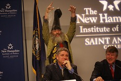 Supreme glitter bombs Randall Terry during a forum at the New Hampshire Institute of Politics at Saint Anselm College in December 2011.