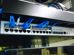 A rack-mounted 24-port 3Com switch