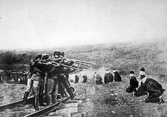 Austro-Hungarian troops executing Serbian civilians, 1914. Serbia lost about 850,000 people during the war, a quarter of its pre-war population.[64]