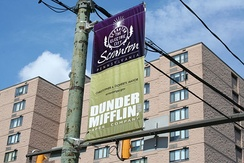 Dunder Mifflin banner in front of Scranton City Hall