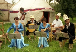 A group of Kyrgyz musicians performing in a yurt camp in Karakol