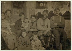 Manuel Sousa and family, 306-2(nd) St., On right end is brother-in-law; next (to) him is father who works on the river; next is Manuel (appears to be 12 years old) wearing sweater and has LOC cph.3b12096.jpg