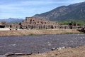 Taos Pueblo, a UNESCO World Heritage site, is an Ancient Pueblo belonging to a Native American tribe of Pueblo people, marking the cultural development in the region during the Pre-Columbian era.