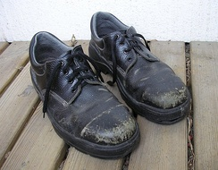 A pair of well-worn steel-toe shoes