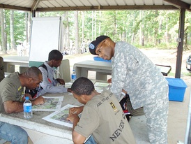 An army trainer mentors new soldiers