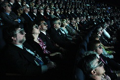 Audiences view a film using 3D glasses.