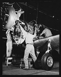 Hanging an engine on a BT-13 Valiant trainer at the Vultee aircraft plant, Downey, California in World War II.[5]