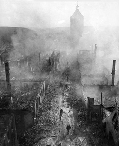 US soldiers advance through the hazy ruins of Waldenburg, Germany, April 1945