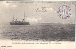 A postcard showing the French cruiser Gloire recoiling from firing artillery at the city during the bombardment of Casablanca August 1907.