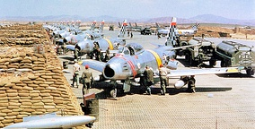 USAF North American F-86 Sabre fighters from the 51st Fighter Interceptor Wing Checkertails are readied for combat during the Korean War at Suwon Air Base
