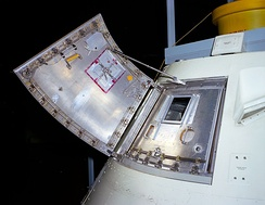The Block I hatch, as used on Apollo 1, consisted of two pieces, and required pressure inside the cabin be no greater than atmospheric in order to open. A third outer layer, the boost protective hatch cover, is not shown.