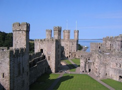 The ward of Caernarfon Castle, showing (from left to right) the Black Tower, the Chamberlain's Tower, and the Eagle Tower. By the 17th century, the castle's domestic buildings had been stripped of valuable materials such as iron and lead.
