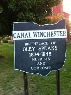 Town sign in Canal Winchester, Ohio, honoring Oley Speaks