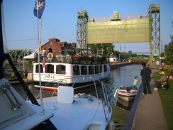 A commercial tour boat locks through Baldwinsville's Lock 24.