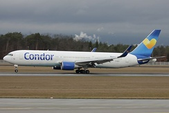 "Condor Boeing 767-300ER wearing interim colors with the ""Sunny Heart"" on the tail"