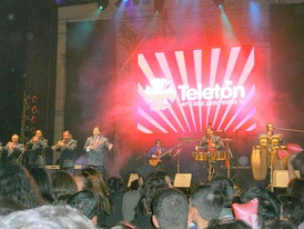 La Sonora de Tommy Rey, a Chilean cumbia band. The image shows the classic instrumentation of the international variants of the genre.