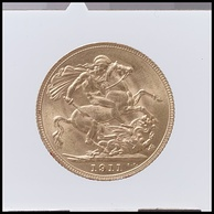 A gold coin dated 1911 with the design being St George and the Dragon