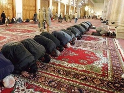 Muslim men prostrating in prayer, at the Umayyad Mosque, Damascus.
