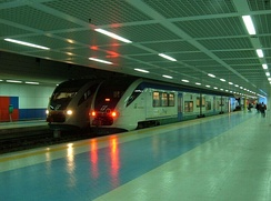 Two trains inside Punta Raisi railway station within Palermo International Airport.