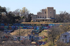 The HOPE Outdoor Gallery, overlooked by the historic Texas Military Academy building, the oldest standing educational building in Texas