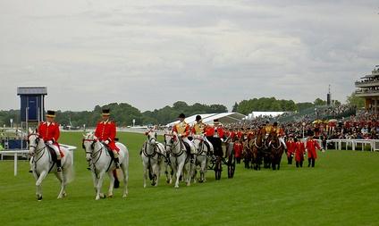 The Royal carriages depart after The Queen's arrival at the races