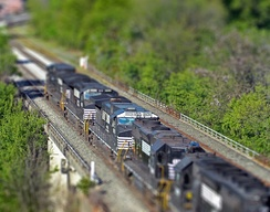 A digitally blurred image of a Norfolk Southern freight train