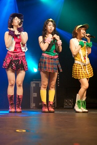 Japanese idol music band AKB48 entertain the audience by performing on stage in Paris, France, 2009