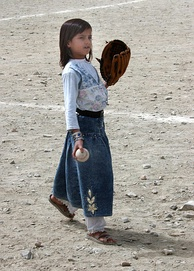 An Afghan girl playing baseball in August 2002