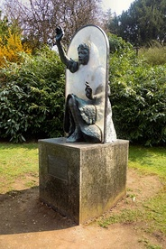 Statue of Alice passing through the looking glass, by Jeanne Argent, in the grounds of Guildford Castle