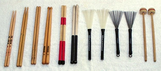 "Tools of the trade: 7N, 5B, ""double bummer"", and side drum No. 3 sticks, standard 19 cane rutes, sheathed 7 cane rutes, nylon brushes, steel brushes, and cartwheels"