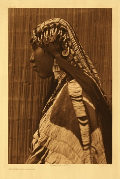 Wishram woman wearing a dentalium shell bridal headdress and earrings, photo by Edward Curtis