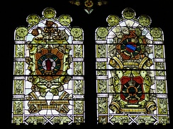 Medieval styled memorial window in Derry, featuring the Red Hand of Ulster as part of the arms of the 36th (Ulster) Division (l)