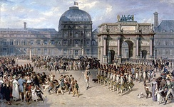 Military review in front of the Tuileries in 1810, by Hippolyte Bellangé. The Arc de Triomphe du Carrousel, which can be seen on the right of this painting, used to be the entrance gate of the palace of the Tuileries and, with the Pavillon de Flore, is all that remains, above ground, of the palace at the site.