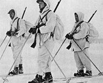 Norwegian volunteer soldiers in Winter War, 1940, with white camouflage overalls over their uniforms