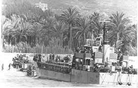 Israeli armored vehicles disembark from a landing craft during an amphibious landing