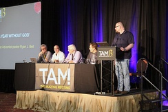 Saunders (left) in 2015, on the Podcaster Panel at TAM13