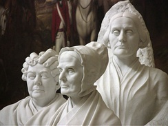 Group portrait monument to the pioneers of the woman suffrage movement, sculpted by Adelaide Johnson (1859–1955) features Elizabeth Cady Stanton, Susan B. Anthony and Lucretia Mott. The portraits are copies of the individual busts Johnson carved for the Court of Honor of the Woman's Building at the World's Columbian Exhibition in 1893