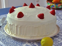 A large cake garnished with strawberries