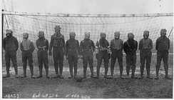 Football team of British soldiers with gas masks, Western Front, 1916