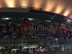Advert for the 2016 NHL All-Star Game outside Bridgestone Arena, featuring players from its clubs based in Canada, and the United States