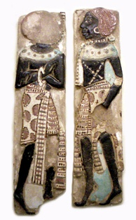 A pair of Nubians, from the royal palace adjacent to the temple of Medinet Habu, from the reign of Ramesses III (1182-1151 BC).