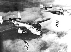B-25Js of the 310th Bombardment Group release 1,000 pound bombs over a cloud-obscured Po Valley in northern Italy, 1944.