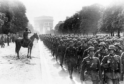 German soldiers march near the Arc de Triomphe in Paris, 14 June 1940