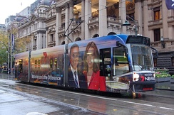 A tram in Seven News Melbourne wrap livery outside Melbourne Town Hall.