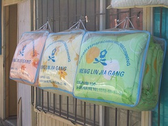 Many writers are not yet aware of the rules for dividing text into words by spaces, and either put a space after each syllable, or run all words together. The manufacturer of these blankets put unnecessary spaces into 'Bishikaike' (the correct pinyin for 比什凯克, 'Bishkek') – but wrote the English text on top with no spaces at all.