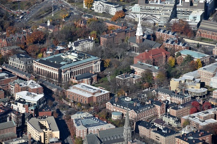 Harvard Yard and environs, from the southeast. The Yard's most prominent buildings bound Tercentenary Theatre: Widener Library (center left), Memorial Church (opposite Widener), University Hall (just beyond Widener, white with white chimneys), and Sever Hall (red roof, opposite University Hall). The Old Yard is the treed area beyond University Hall.