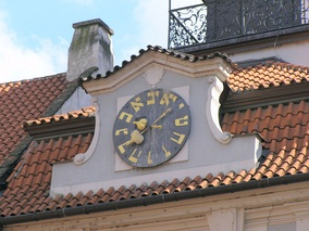 The lower clock on the Jewish Town Hall building in Prague, with Hebrew numerals in counterclockwise order.